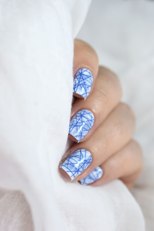 Blue stamping marble nail art by Marine Loves Polish
