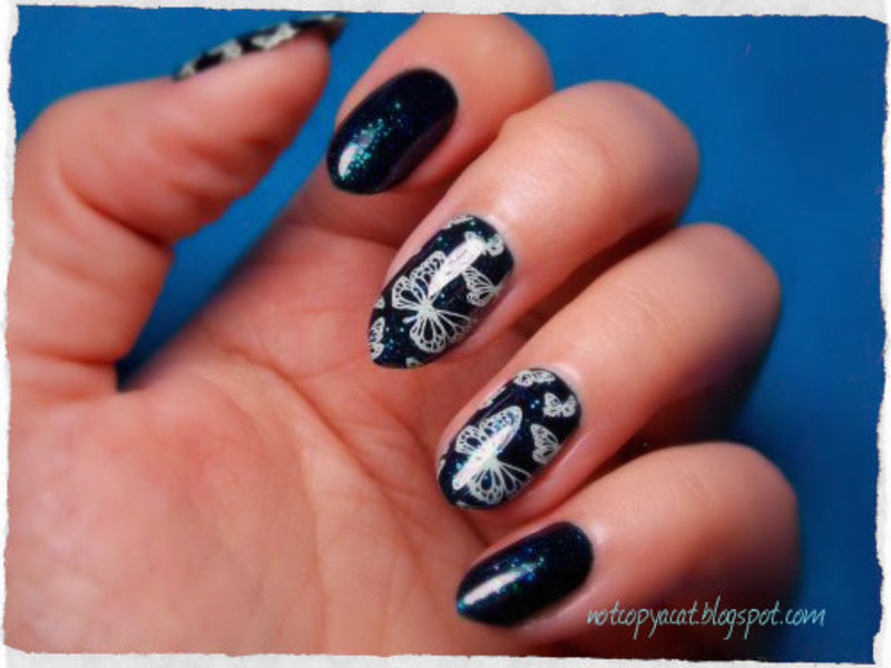 Butterflies in the space. nail art by notcopyacat