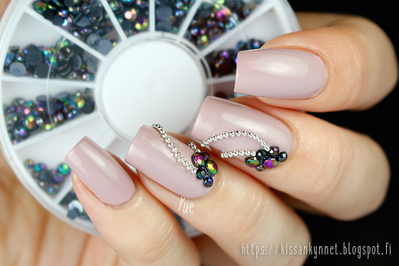 Black rainbow rhinestones nail art by Yue