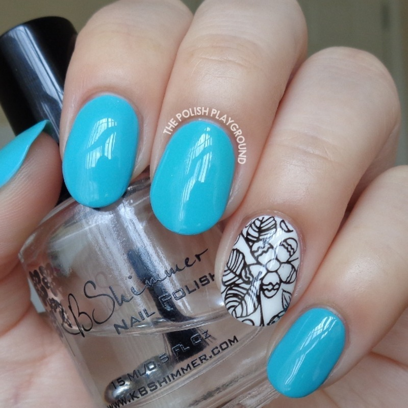 Turquoise Blue with Black and White Floral Accent nail art by Lisa N