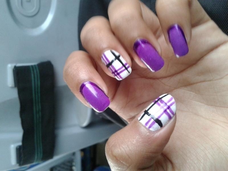 The puple striper nail art by Simran Aggarwal