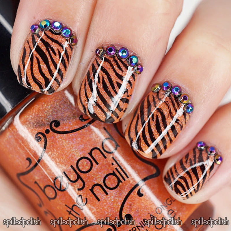 Tiger Stripes nail art by Maddy S