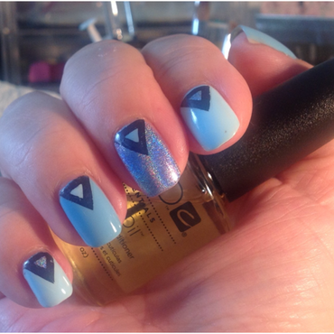 Blue Triangles nail art by Ronit