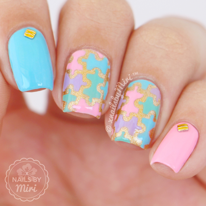 Colorful Puzzle Pieces nail art by xNailsByMiri