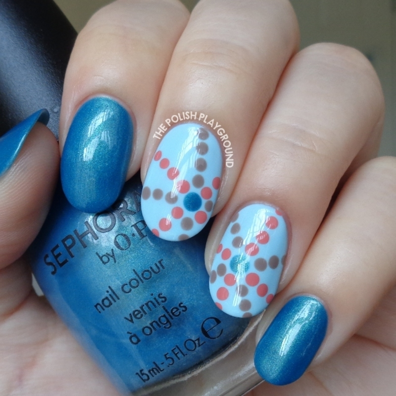 Blue with Starburst Inspired Dotting Pattern nail art by Lisa N