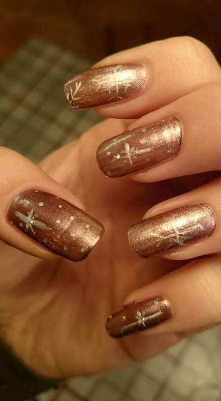 Snowflakes nail art by Sabina Salomonsson