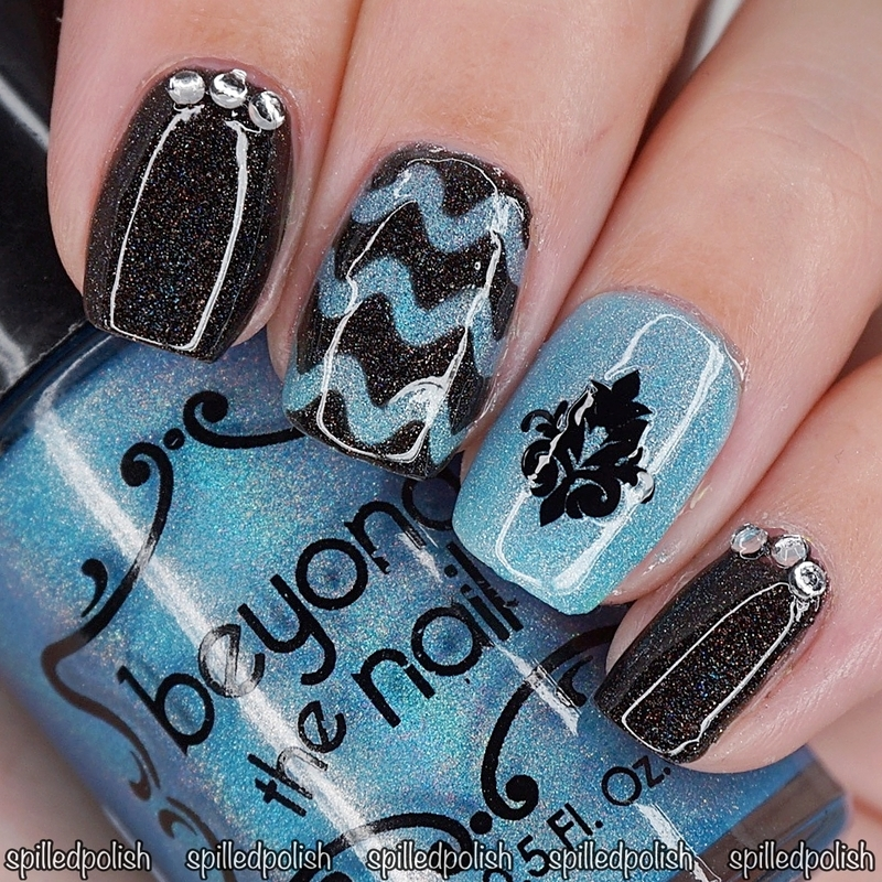 Holographic Black and Blue Nails nail art by Maddy S