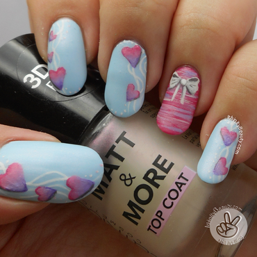 Girly hearts and bow nail art by Ithfifi Williams