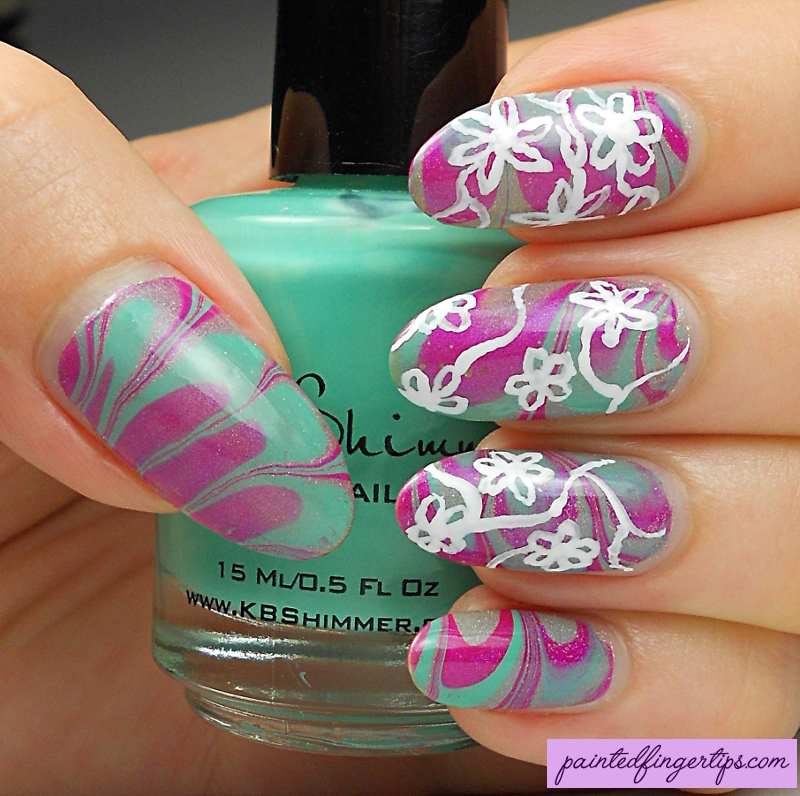 Water marble with freehand flowers nail art by Kerry_Fingertips