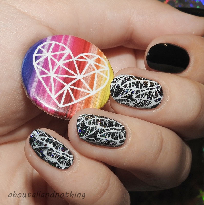 Black, holographic feathers nail art by Kasia