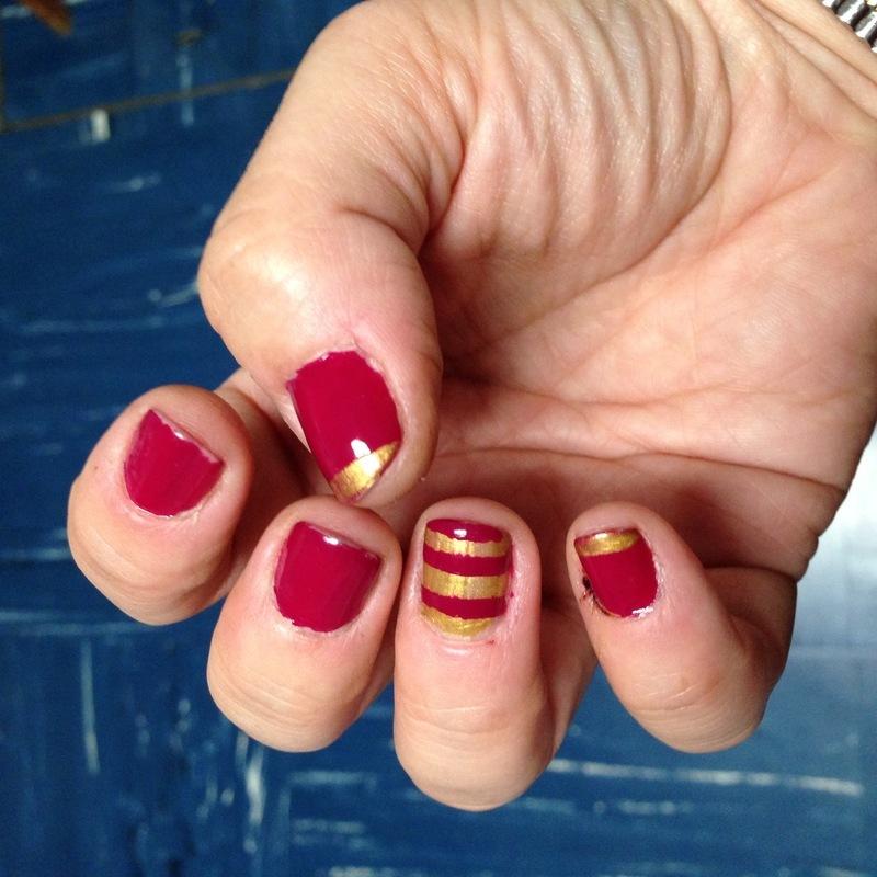 Maroon & gold stripes nail art by Rezingona