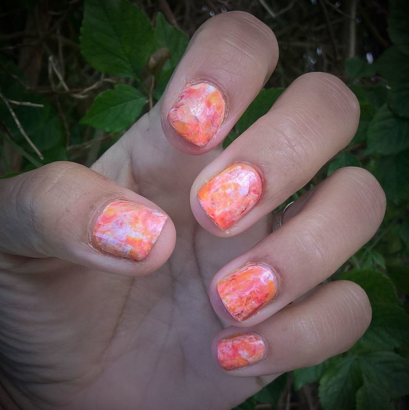 White, pastel orange and shimmery orange Smooshy  nail art by Avesur Europa