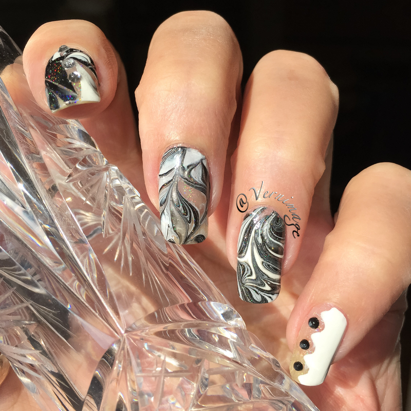 Black, white and negative space nail art by Vernimage