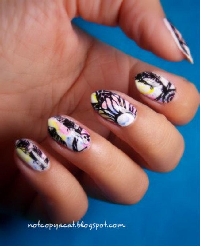 A dreamcatcher on a blurry background nail art by notcopyacat