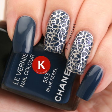 Blue with silver filigrees nail art by Claire Kerr