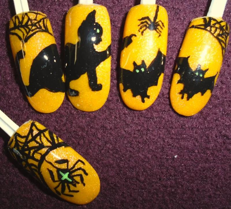 Halloween: cats, bats and spiders nail art by Rhianne Nagels