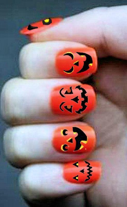 Jack O Lantern Faces nail art by FRANCESCA SPORTELLA