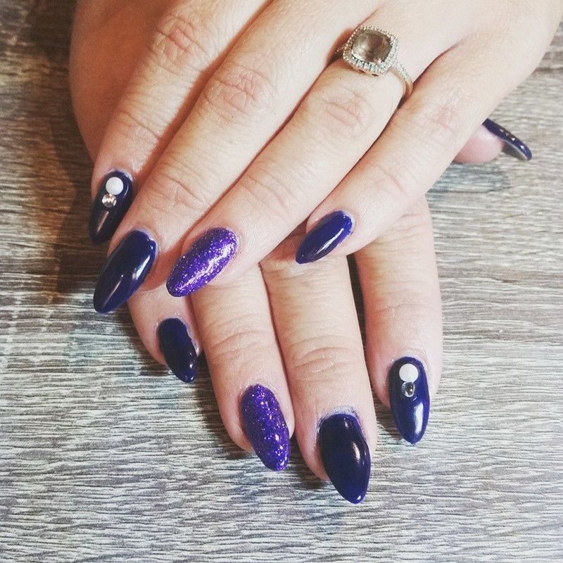Deep blue with purple sparkle and swarovski accents   nail art by Ailesh Abrams
