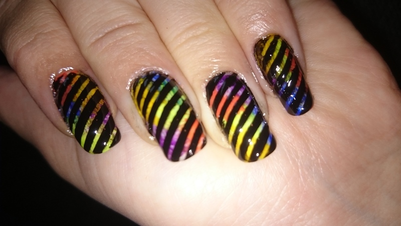 Striped happiness  nail art by Sabina Salomonsson