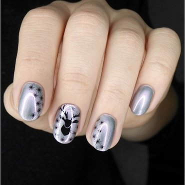 Black reindeer on holo silver nail art by barbrafeszyn