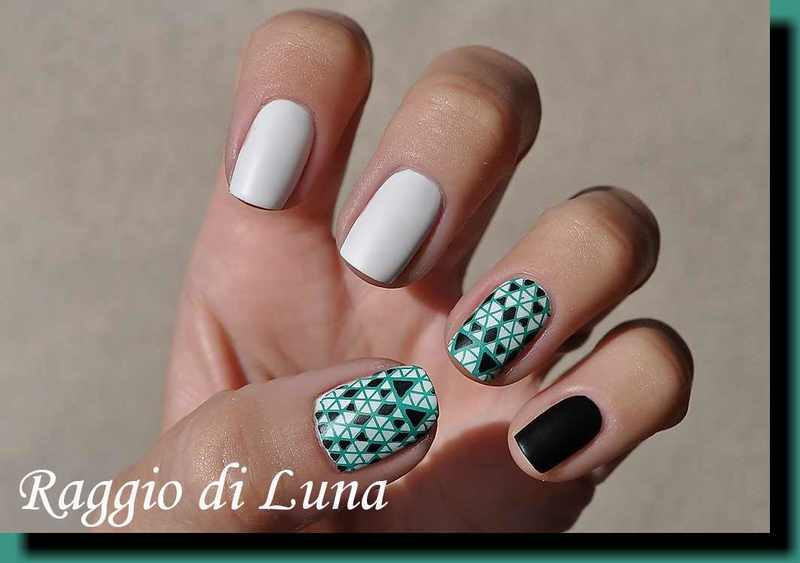 Stamping: Green abstract triangolar pattern on white nail art by Tanja