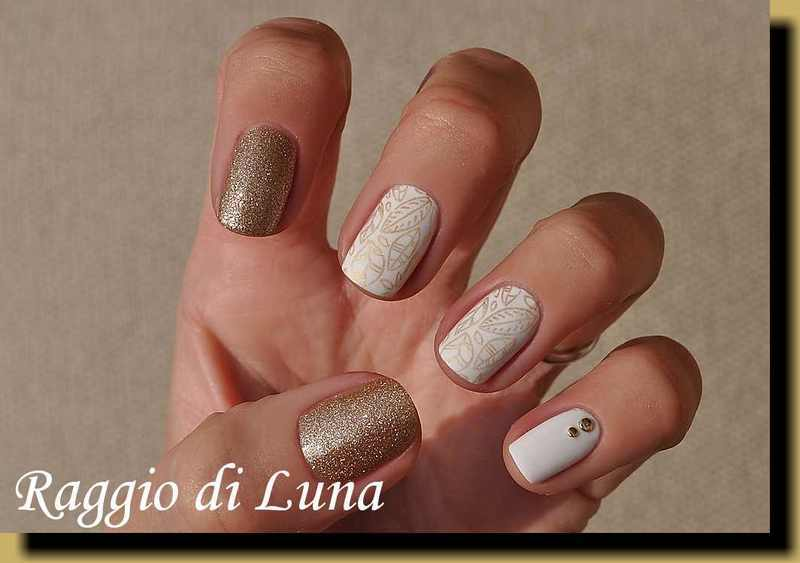 Stamping: Golden leaves on white nail art by Tanja