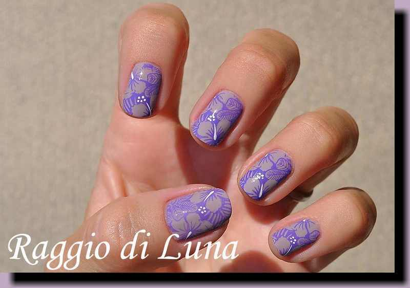 Stamping: Purple floral pattern on light lilac nail art by Tanja