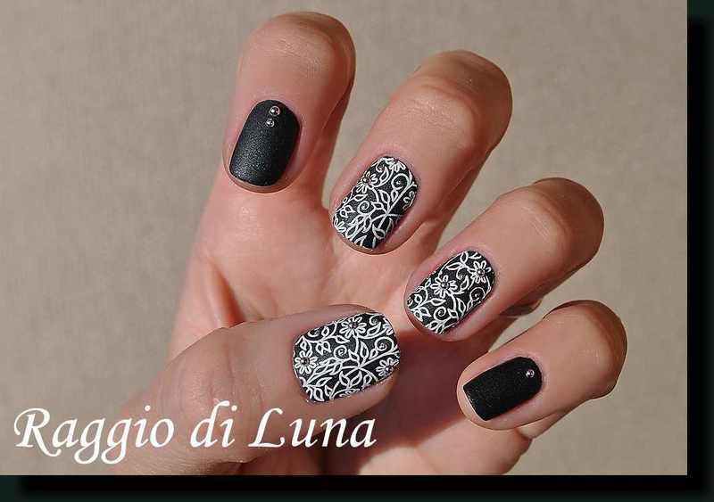 Stamping: White floral pattern on matte dark green nail art by Tanja