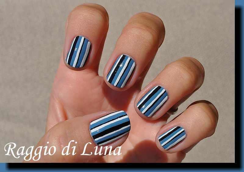 Black & white & blue vertical stripes nail art by Tanja