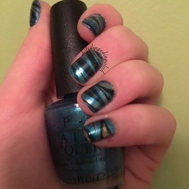 Blue, black and Gold Watermarble nail art by lifedippedinpolish