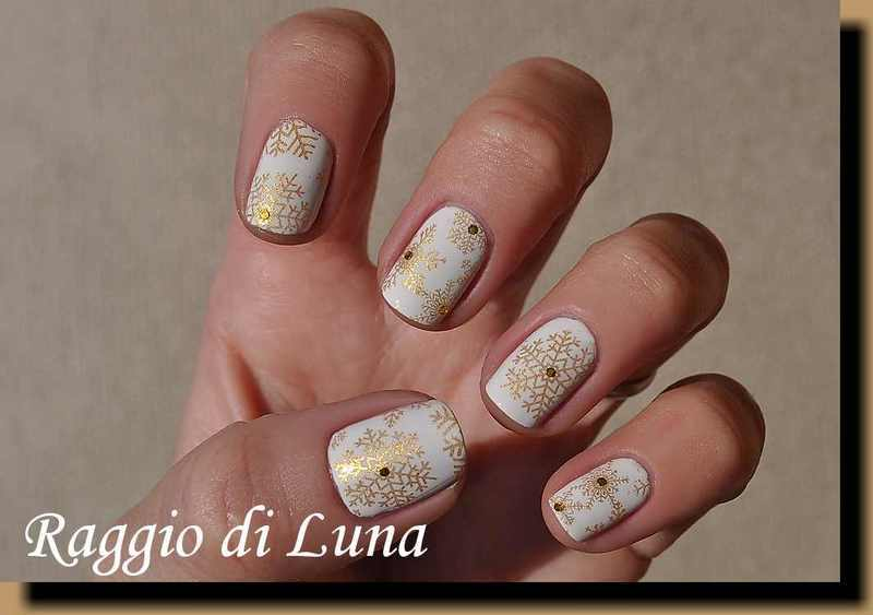 Stamping: Golden snowflakes on iceberg white nail art by Tanja