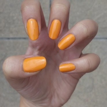 Orange nail art by Lucy