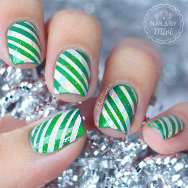 Green Holo Candy Cane nail art by xNailsByMiri