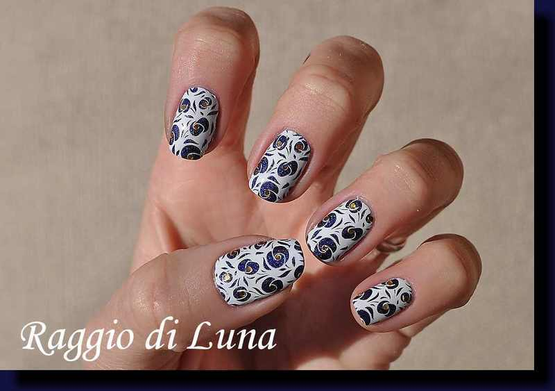 Stamping: White floral pattern on dark blue holo nail art by Tanja