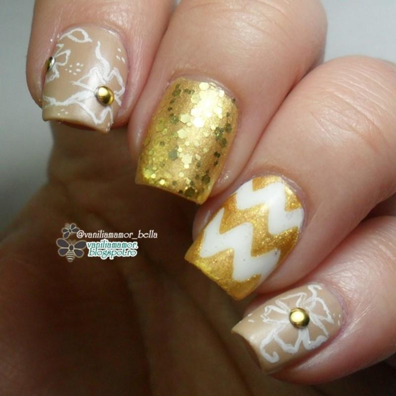 gold nail art by Isabella