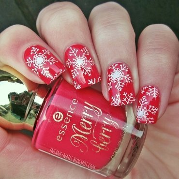 Red snowflakes nail art by Sanela