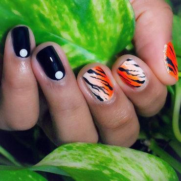 Tiger Inpsired Nail Art nail art by Gabrielle