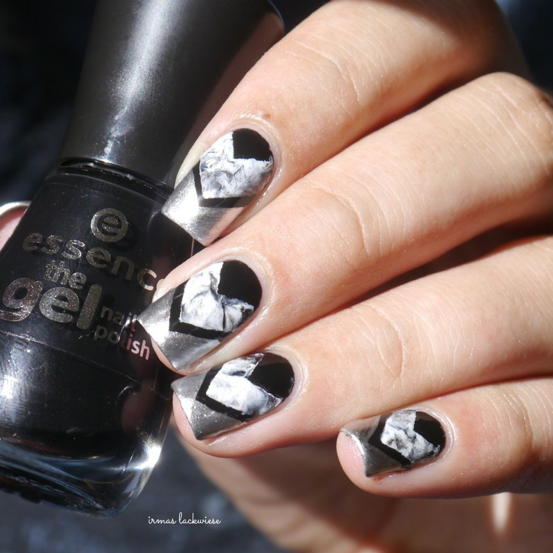 black marble and silver triangles nail art by irma