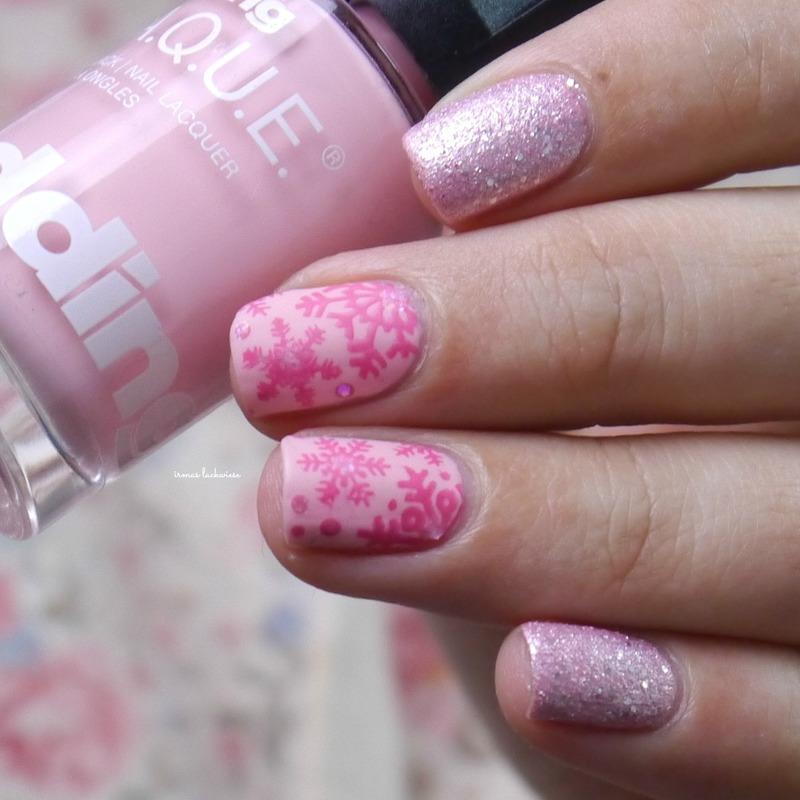 pink snowflakes nail art by irma