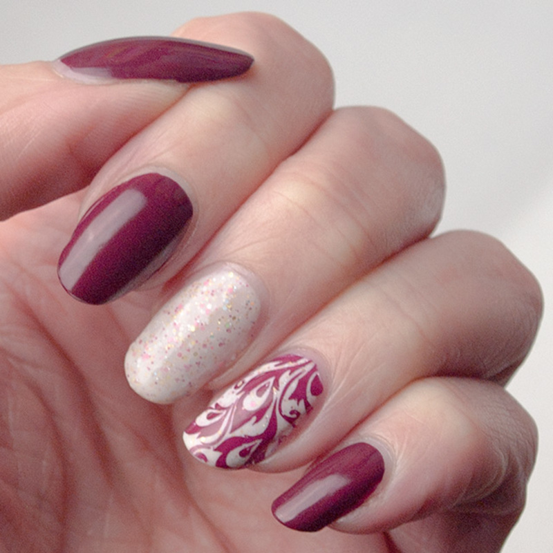 Abstract feathers nail art by What's on my nails today?