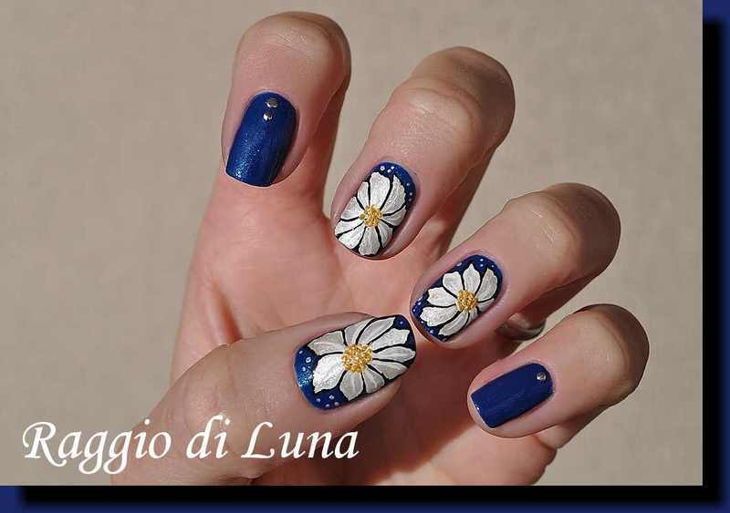 Silver flowers on iridescent blue nail art by Tanja