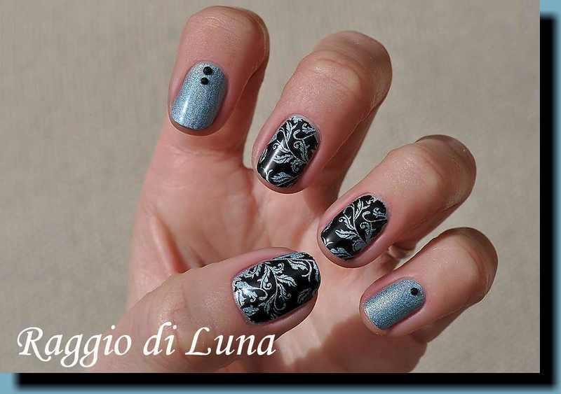 Stamping: Black leaf pattern on light blue holo nail art by Tanja