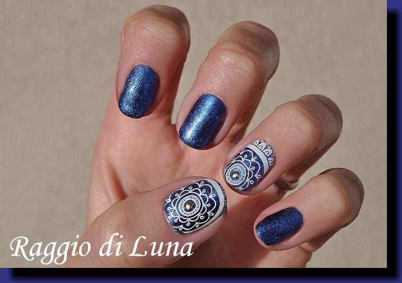 UV gel manicure - White floral pattern on chameleon blue nail art by Tanja