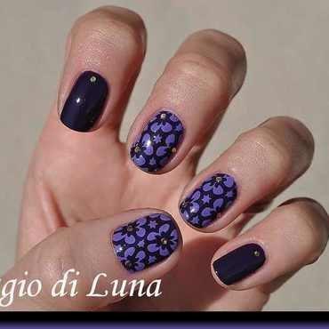 Stamping: Light purple flowers on dark purple nail art by Tanja