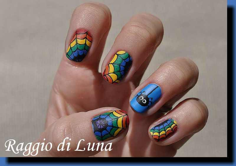 Rainbow spider web nail art by Tanja
