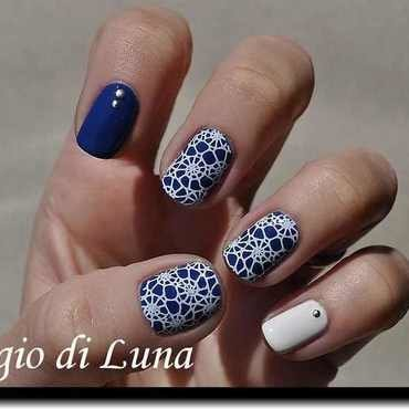 Stamping: White nautilus pattern on blue nail art by Tanja