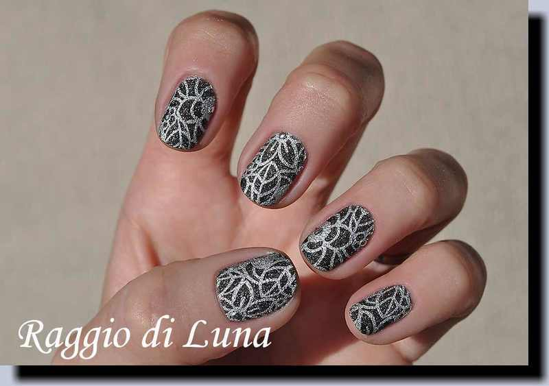 Stamping: Silver floral pattern on textured black nail art by Tanja