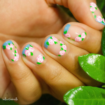 Blue tips with flowers! nail art by Gabrielle