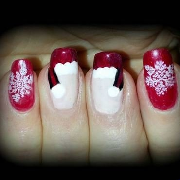 Santa hats and snow on pink chrome nail art by Maureen Spaulding