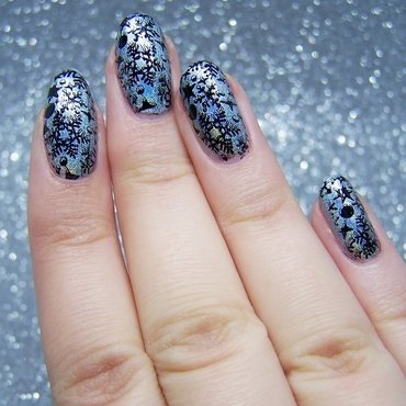 Snowflakes nail art by Lucy
